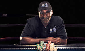 Evander Holyfield promoting poker with a Real Deack